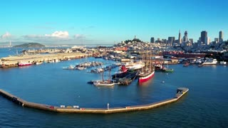 Aerial view of San Francisco Bay and boats with city in background 4