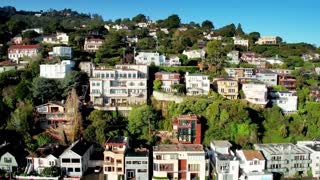 Aerial view of San Francisco hillside houses by ocean 5