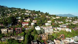 Aerial view of San Francisco hillside houses by ocean 6