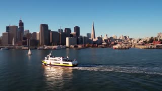 Aerial view of ship traveling by San Francisco skyline 2
