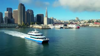 Aerial view of ship traveling by San Francisco skyline 4