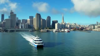 Aerial view of ship traveling by San Francisco skyline 5