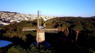 Aerial view of windmill on hills in San Francisco overlooking cityscape 2