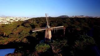 Aerial view of windmill on hills in San Francisco overlooking cityscape 3
