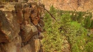 Aerial view of woman rock climbing a mountain