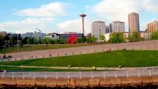 Bike ride by Seattle waterfront with space needle in background 2
