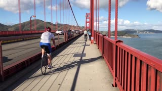 Bike riders cross Golden Gate Bridge on nice day 2