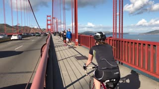 Bike riders cross Golden Gate Bridge on nice day 3
