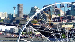 Close up of ferris wheel next to Seattle skyline 2