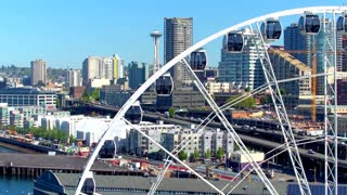 Close up of ferris wheel next to Seattle skyline 3
