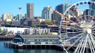 Close up of ferris wheel next to Seattle skyline 4