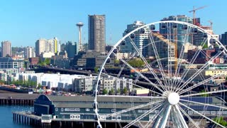 Close up of ferris wheel next to Seattle skyline