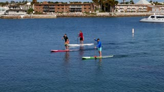 Closeup of paddle boarders on blue ocean water
