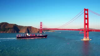 Container ship travels under Golden Gate Bridge by mountains 2