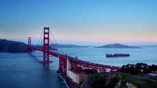Container ship travels under Golden Gate bridge by mountains 6