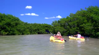 Couple kayaking on clear ocean sunny day by tropical island 5