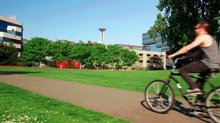 Couple rides bikes through Seattle park
