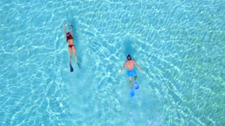 Couple Snoreling in Tropical Clear Blue Water from Aerial Drone 2
