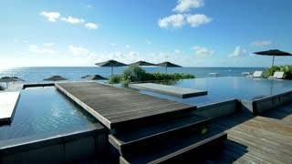 Dock over tropical infinity Pool