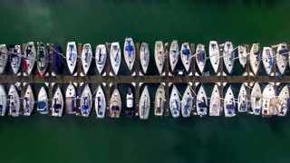Drone view above boats docked in bay