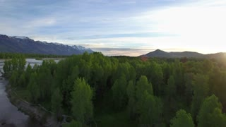 Drone view from tree tops of mountains and river 3