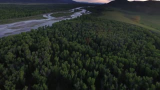 Drone view from tree tops of mountains and river 4