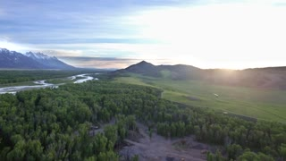 Drone view of mountains and gorgeous sunset in Wyoming