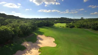 Drone view of San Antonio golf course under blue sky 2