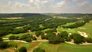 Drone view of San Antonio golf course under blue sky 3