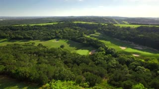 Drone view of San Antonio golf course under blue sky 4