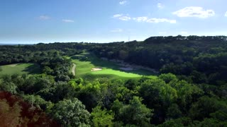 Drone view of San Antonio golf course under blue sky 5