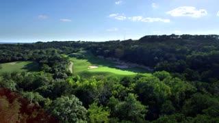 Drone view of San Antonio golf course under blue sky 5
