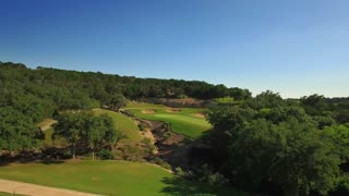 Drone view of San Antonio golf course under blue sky