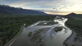 Drone view of sunset sky with snowcapped mountains and river 4