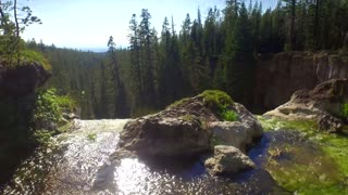 Drone view of waterfall drop off in Oregon forest 2