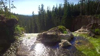 Drone view of waterfall drop off in Oregon forest