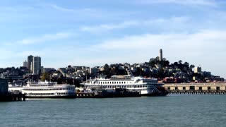 Ferry docked in San Francisco Bay with city in background