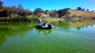 Fishermen on a boat lake fishing