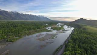 Gorgeous drone view of mountains and forest by river 3