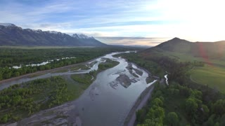 Gorgeous drone view of mountains and forest by river 4