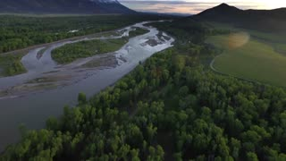 Gorgeous drone view of mountains and forest by river 6