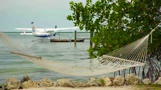 Hammock by sea and closeup view of sea plane