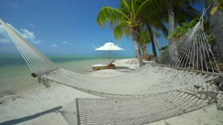 Hammock in front of tropical ocean on sunny day 2