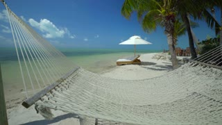 Hammock in front of tropical ocean on sunny day 3