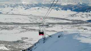 Jackson Hole ski lift descends down snow covered mountain