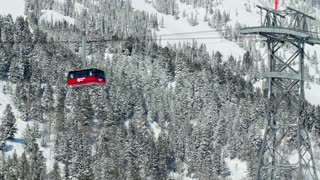 Jackson Hole ski lift moves along mountainside