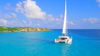 Luxury Catamaran Yacht Sailing off Tropical Coast From Aerial Drone 7