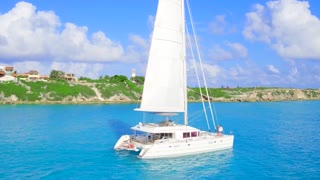 Luxury Catamaran Yacht Sailing off Tropical Coast From Aerial Drone 8