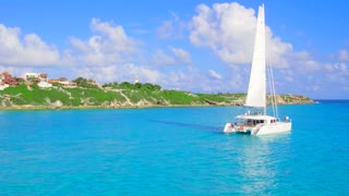 Luxury Catamaran Yacht Sailing off Tropical Coast From Aerial Drone 9
