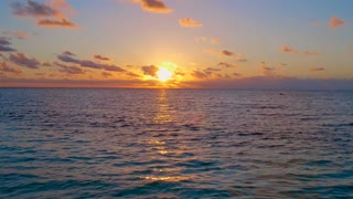 Morning Sunrise over Tropical Ocean from Aerial Drone